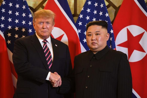 United States President Donald Trump shakes hands with North Korean leader Kim Jong-Un before their meeting in Hanoi, Vietnam. Photo:  AFP