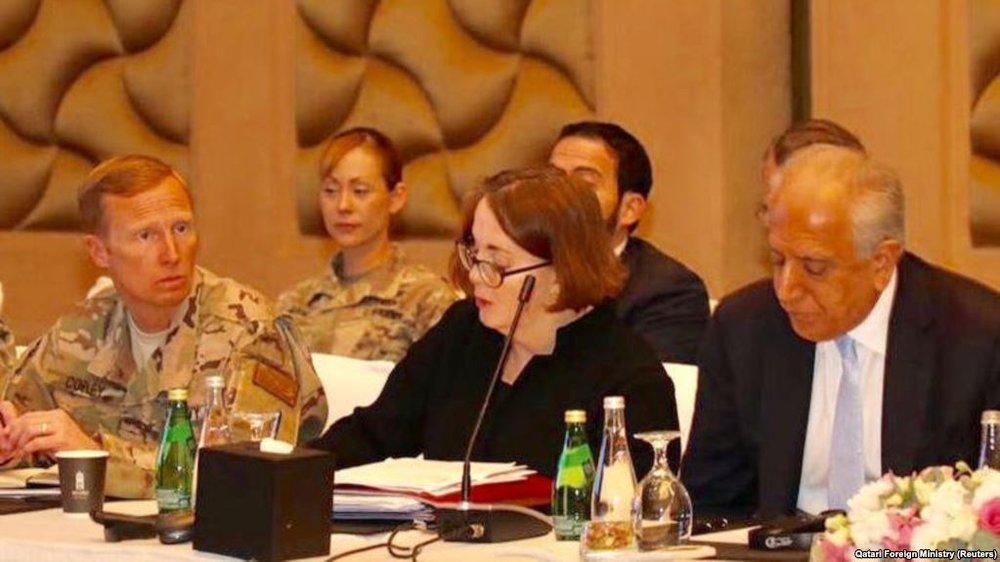 U.S. special representative Zalmay Khalilzad (right) at the peace talks in Doha in March; Photo:  RFE/RL