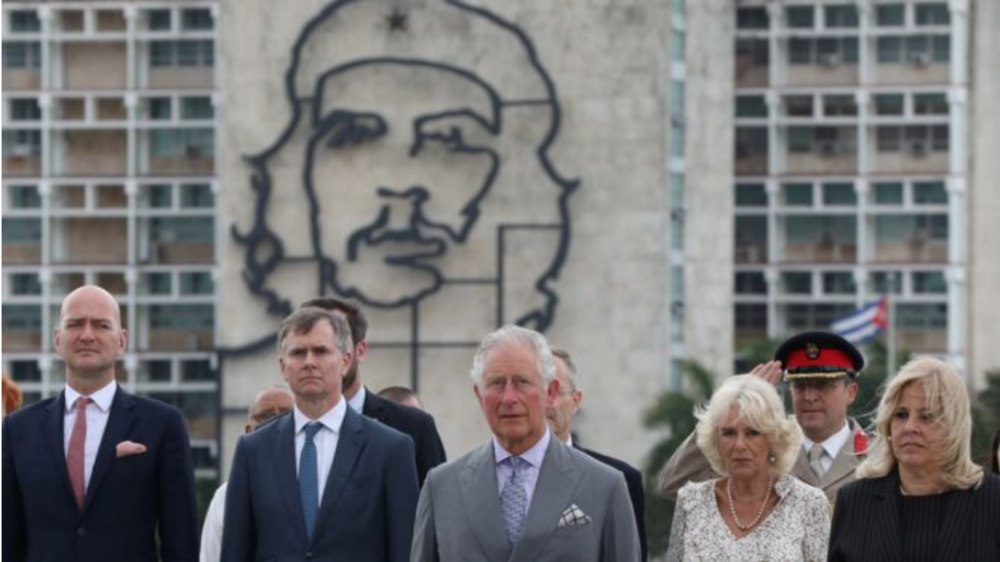Their Royal Highnesses in Cuba posing near an image of Che Guevara.  Photo: Reuters/  BBC News