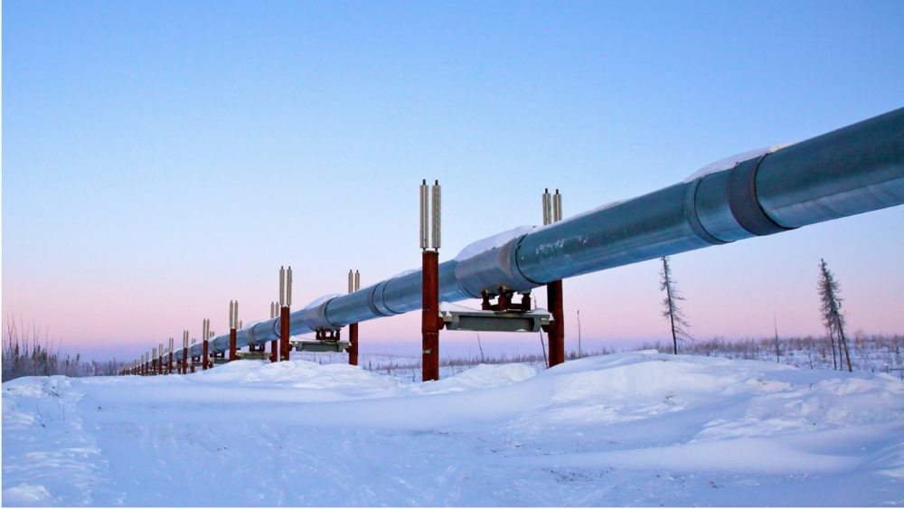 A gas pipeline on top of snowy terrain. Photo:  Grist