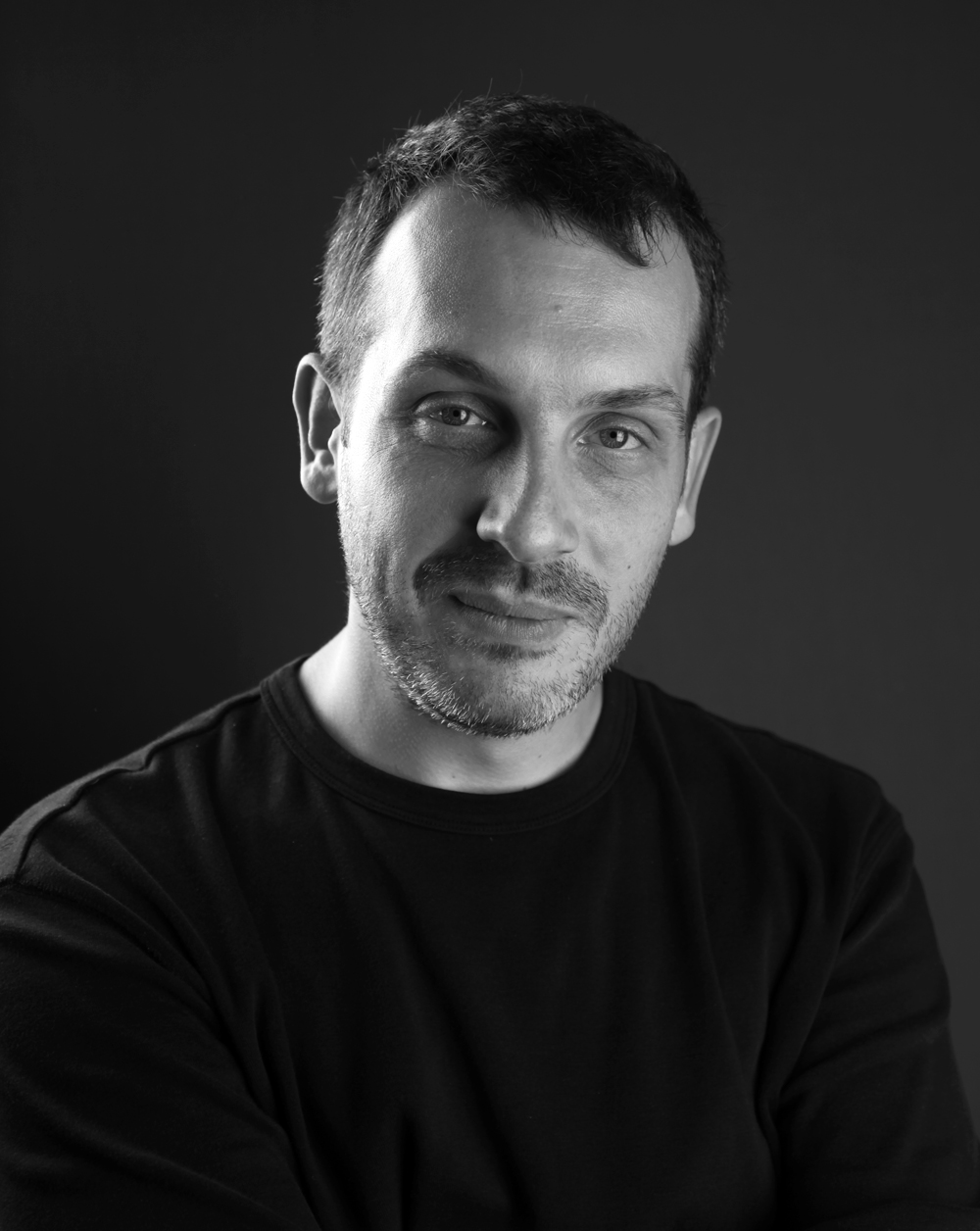 Bio |Predrag Milosevic - Predrag Milosevic (b. 1974), was born in 1974 in Belgrade, the capital city of the former Yugoslavia (now the Republic of Serbia). He completed an MFA at the University of Arts, Belgrade (2008),where he focussed on Digital Arts and Film and Video. His work blurs the lines between Artist Film and Video and NetArt often drawing on live performance, theatre and dance,which are woven together with self-composed musical compositions and abstract digital works, which blend reality and fiction and in so doing use digital forms and moving image to create visual montages that move between virtual and physical space, reality and dream, the real and the imagined. His works have been reported to have a transformational affect in their ability to distil time and context and to plague the memory through the use of sound, abstract digital imagery and figurative movement,which combine to produce invented imaginary or nostalgic worlds that force us to contemplate ourselves and our immediate surroundings. He has made new work for commissions and exhibitions internationally including: 'Secret Garden (2012), a new commission for the Secret Garden, a one-act ballet choreographed and staged by Sasha Evitomova, performed by Nina Ananiashvili State Ballet of Georgia —Music by Sebastian Plano and Ólafur Arnalds, presented at the Alexander Griboedov State Russian Drama Theatre, Tbilisi, Georgia; Awaking (Budjenje),(2010) an Interactive cyber ballet Directed by Bosko Djordjevic, Choreography: Michele Merola.Terazije Theater, Belgrade, Serbia; Multimedia (2009), for the 25th Universiade 2009 Opening Ceremony, Belgrade, Serbia; Winter Gardens (2009) – for the 40th International Theatre Festival of the Venice Biennale, 'Mediterraneo'; Fantasmagorie (2008), a new commission for a film directed by Rastko Ciric dedicated to Emil Chol's first animated cartoon, presented in Paris, France and subsequently represented again that year at the Monstra International Animated Film F