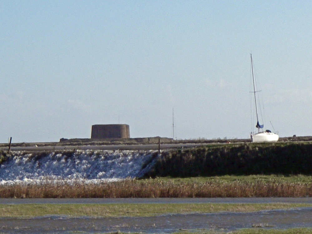 Sea coming over the Aldeburgh river wall - photo credit Andrew Hawes