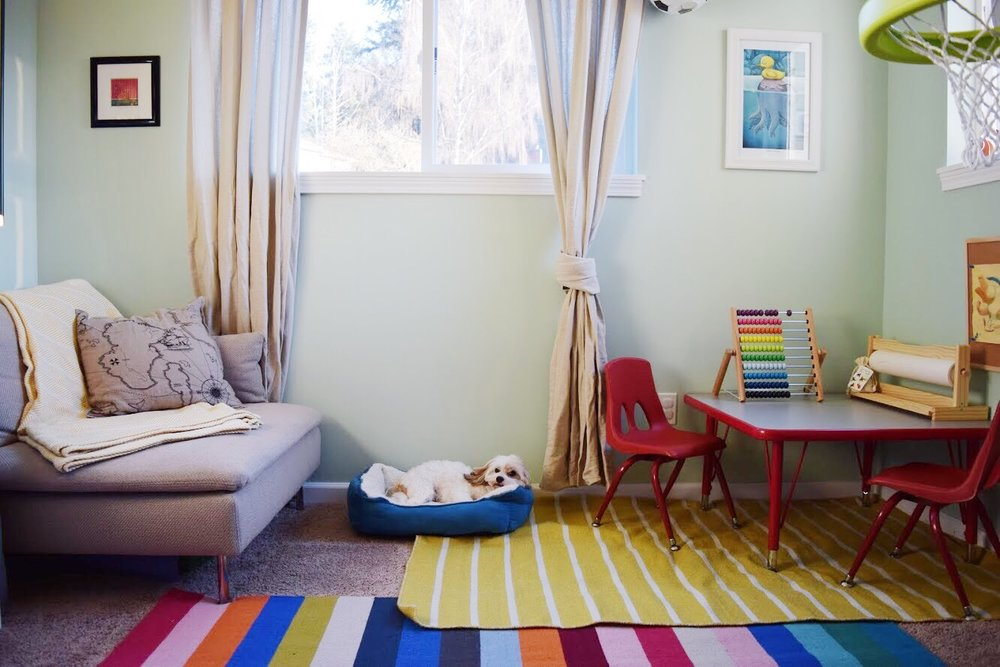 An extra inexpensive rug was added under the table so project spills can happen without worrying about ruining the carpet.