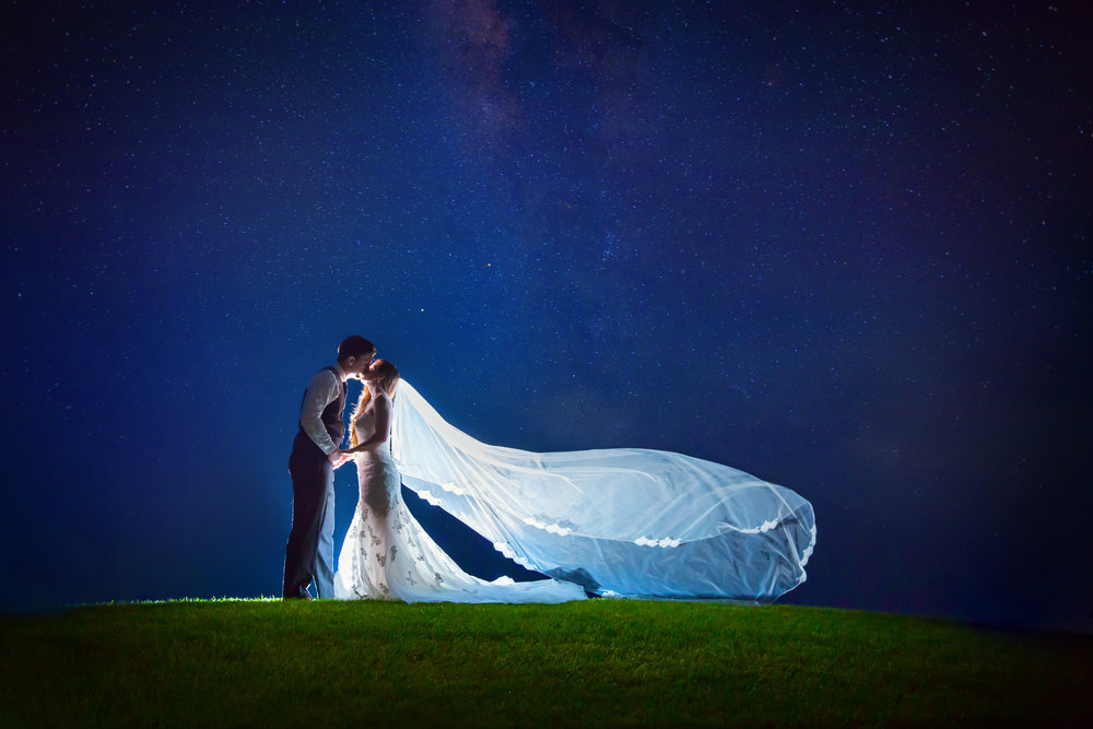 This one just takes our breath away! There's nothing more magical than an epic wedding night photo!