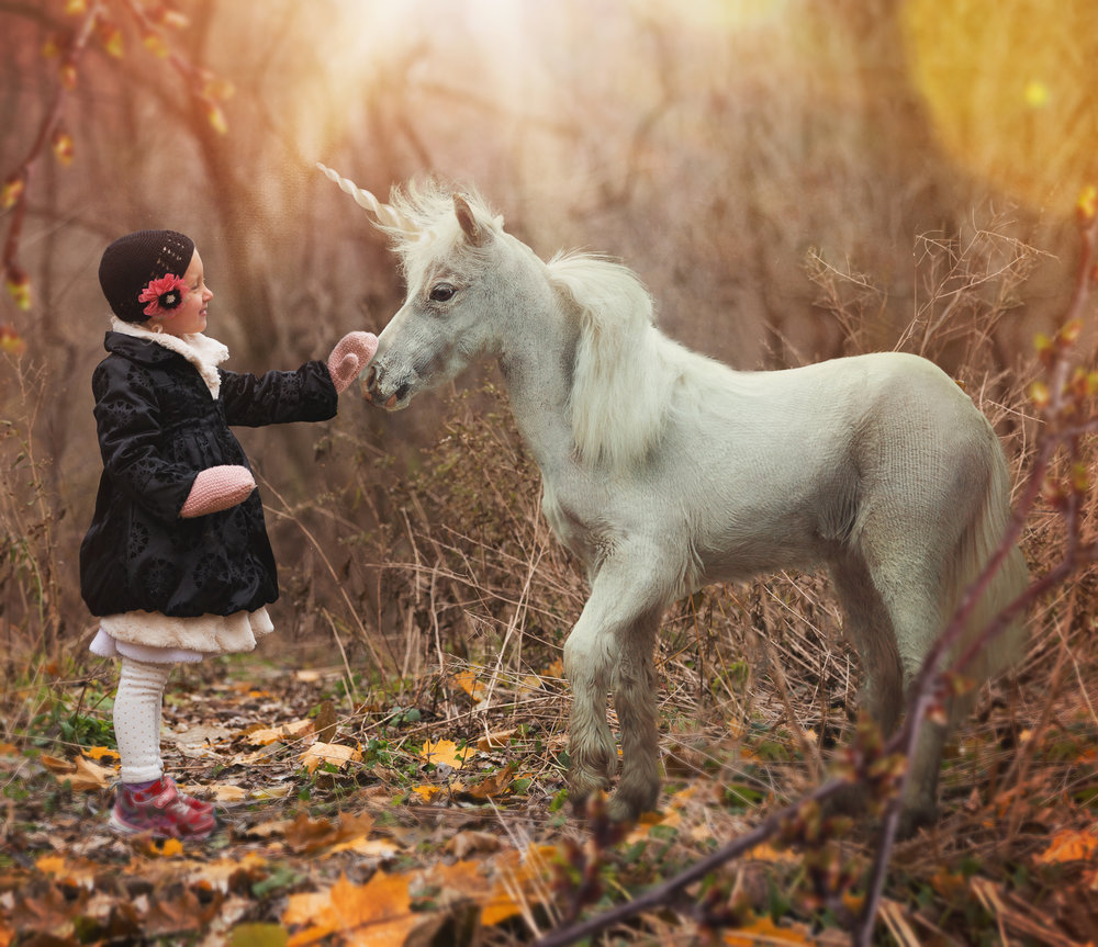 Peyton…and a Unicorn! Her Mom gave this to Peyton as a  huge  canvas for Christmas!