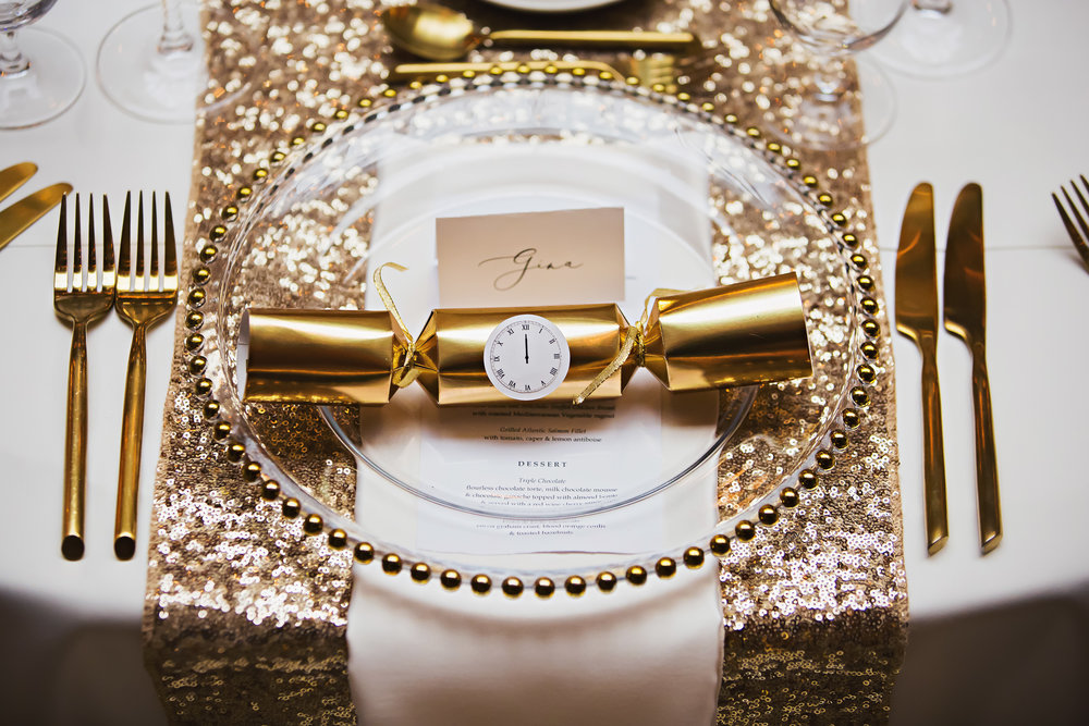 "Could you think of a better wedding favour than holiday crackers? They were filled with Hershey's kisses…so no one went without a kiss at midnight! I was drooling over the gold cutlery (now on my ""need in my own house"" list)."