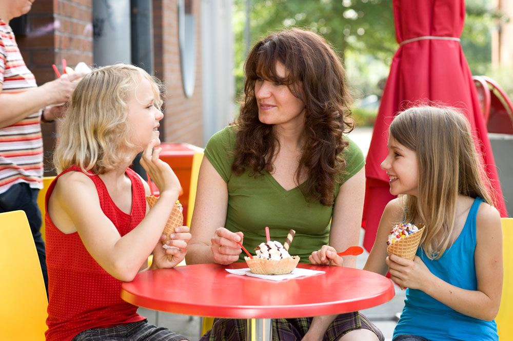 mother-and-daughter-enjoying-ice-cream-together-outside.jpg