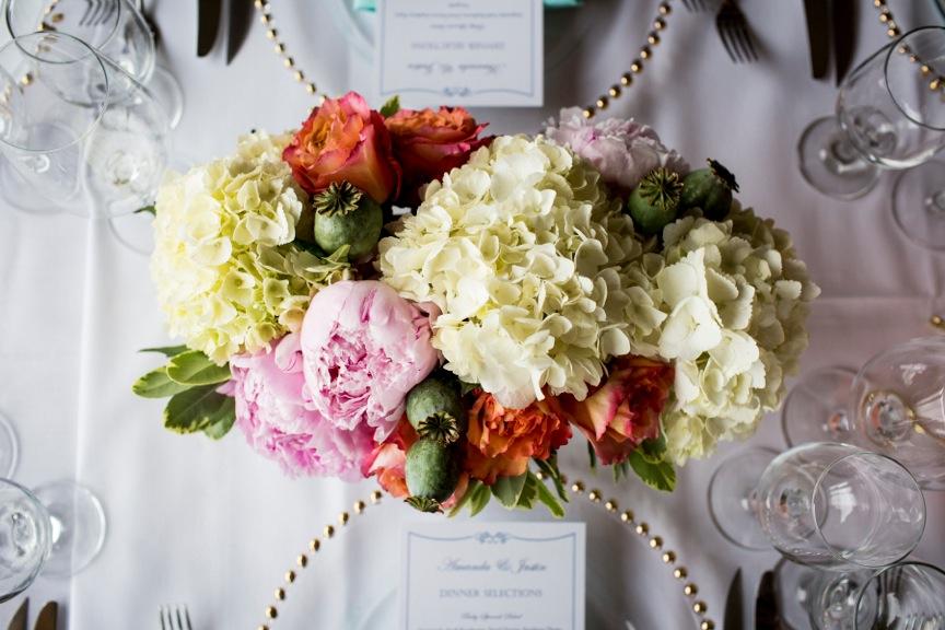 Vail Valley Wedding table arrangement peonies hydrangeas,roses,poppy pods .jpeg