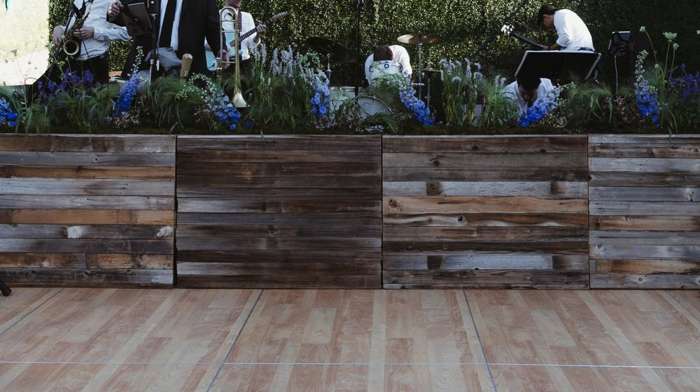 GeorgiaCodyWedding+Details-0046 Wildflowers with movement in wooden pallet box planters lining Dance Floor.jpg
