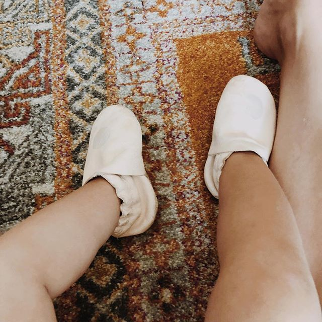 """When all your shoe model cares about is """"boob boob boob."""" You make this snuggled lap photo work. Our absolute favorite and daily worn, @campergeneralstore moccs.  These beauties + the black hole sun version available in the shop!"""