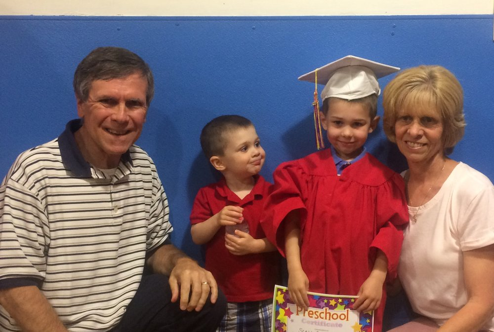 Graduation day with Grandma and Grandpa