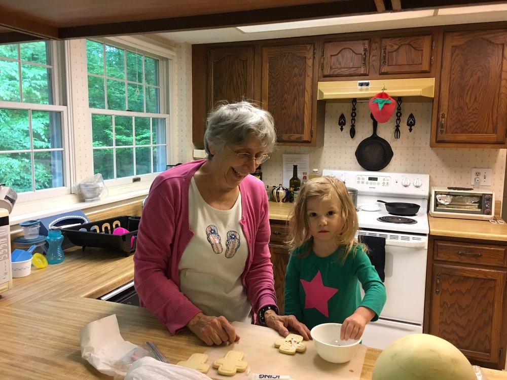 Helping Grandma decorate cookies