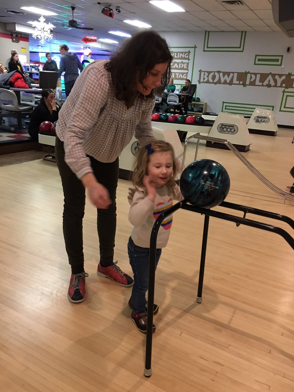 Learning to bowl with mom!