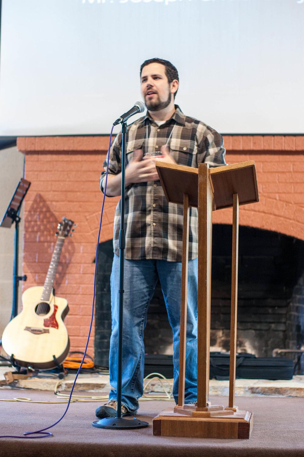 Joseph leading Youth Group service