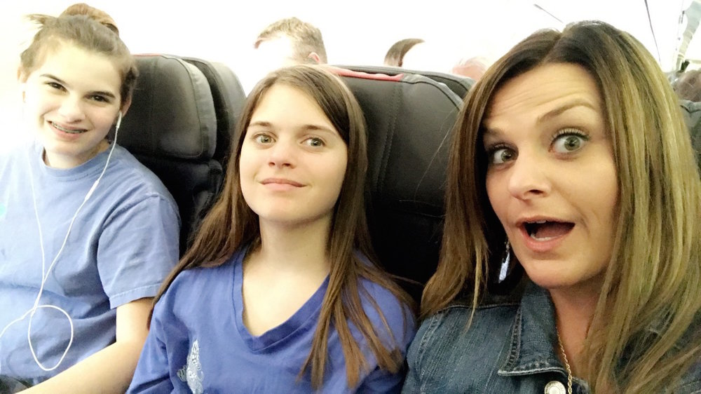 Two of my nieces and I on our way to Chicago for the weekend. Our surprised smiles showed the relief we made the flight after we rushed to the airport after their last finals of the school year.