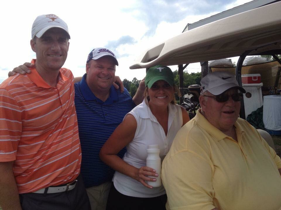 Playing in a charity golf tournament with my dad and brothers