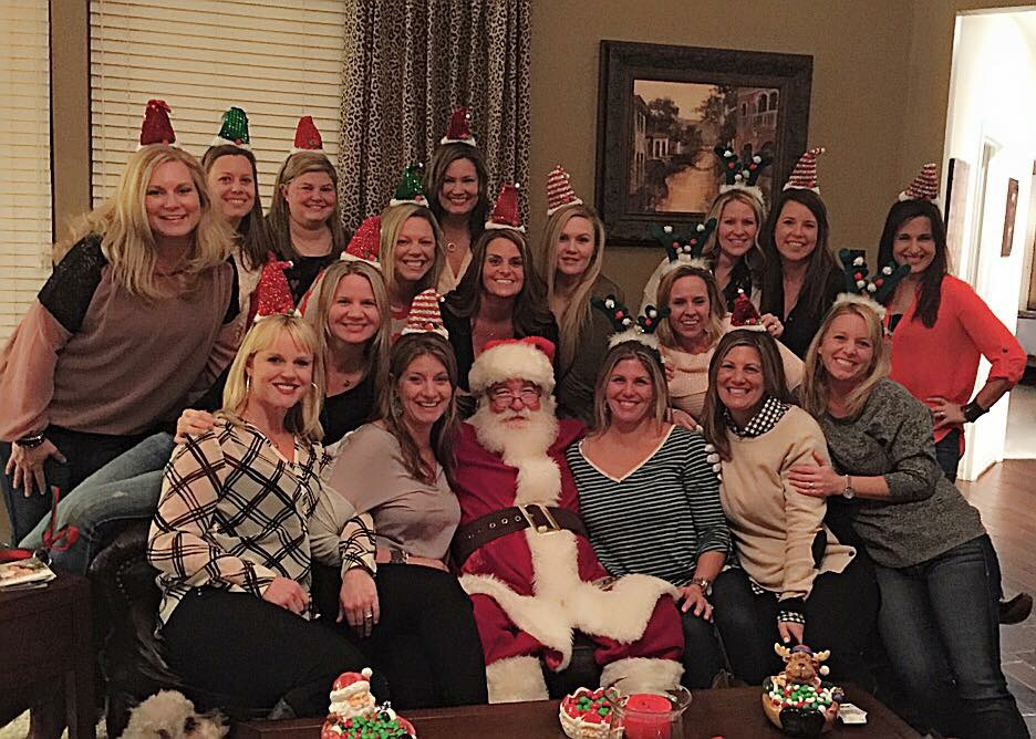 I surprised my friends with a visit from Santa at my annual ornament and fundraising Christmas party.