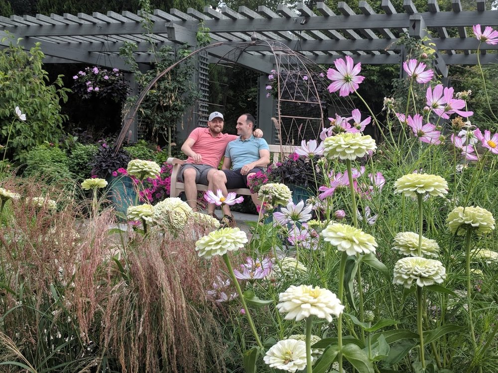 Dennis' mom likes taking candid photos. Here we are enjoying some quiet alone time at the Denver Botanic Gardens