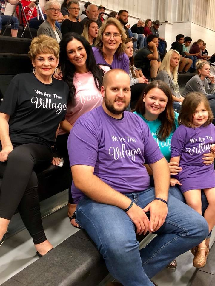 "Our family and friends bought shirts that say, ""We Are The Village"" to support our adoption!"