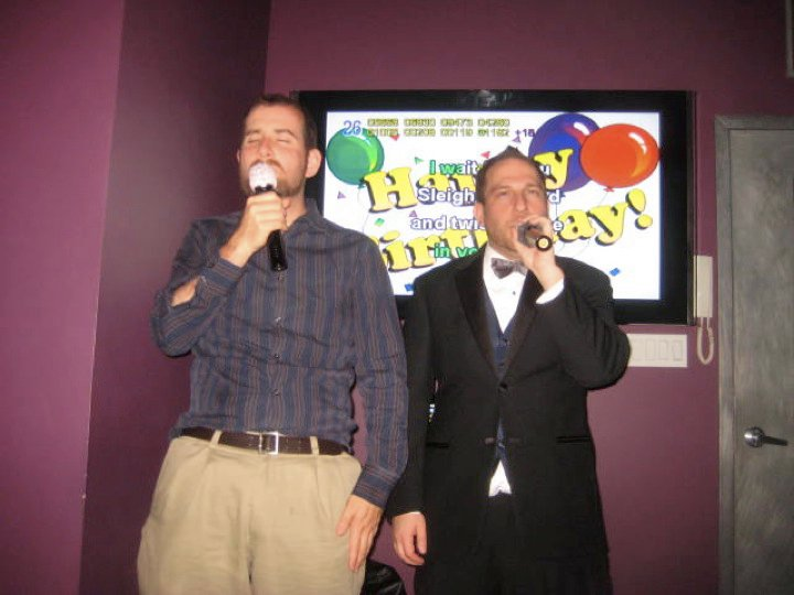 Singing karaoke for Shalom's birthday (he's in the tux)