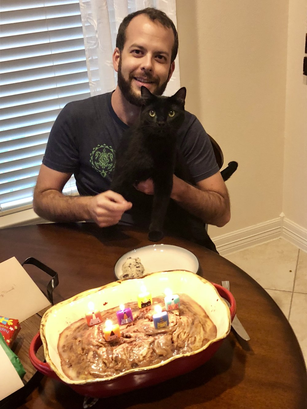 Daniel enjoying his cake with our cat Gryff