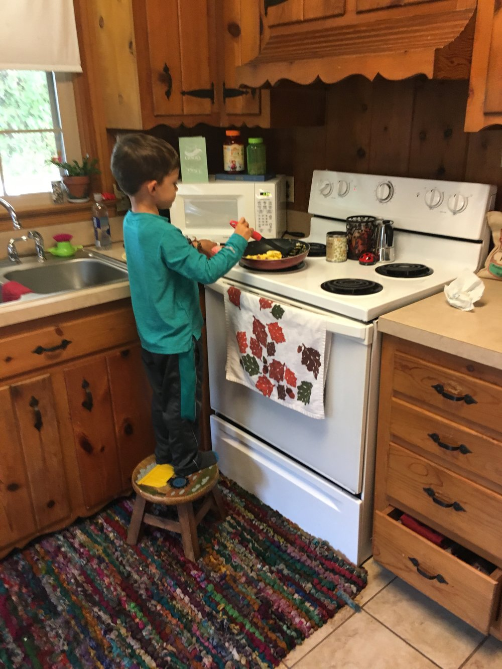 A Montessori 6 year old cooking weekend breakfast for his family.