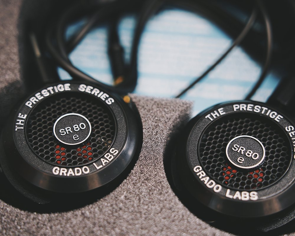 Grado SR80e: the best bang for the buck headphones for private listening.