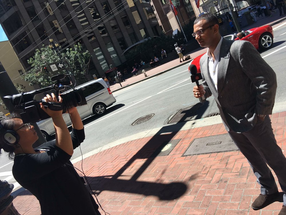 Reporting on Market Street, San Francisco, CA