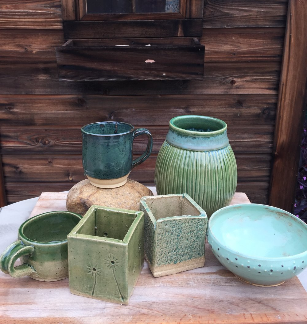 Amaco True Celadon, Coyote Pistachio Shino, Coyote Pam's Green, Laguna Cerulean, Coyote Gunmetal Green. Work by studio members and students.