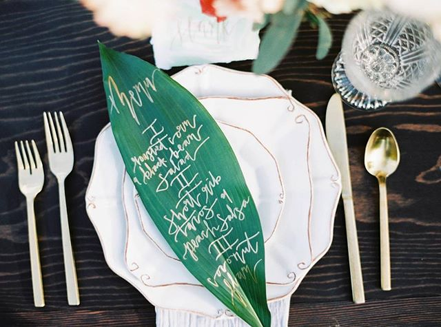 One more because these hand lettered menus on ficus leaves made the trek from Nebraska to Arizona. Definitely worth sacrificing my normal carry-on items🌿 . . . . .  Photography: @maryclaire_photography  Planning: @cococollectiveweddings  Florals: @arraydesignaz  Stationery: @libbyraestudio  Rentals: @eventrentsaz  Venue: @royalpalmsweddings  Videography: @evanvillavaso