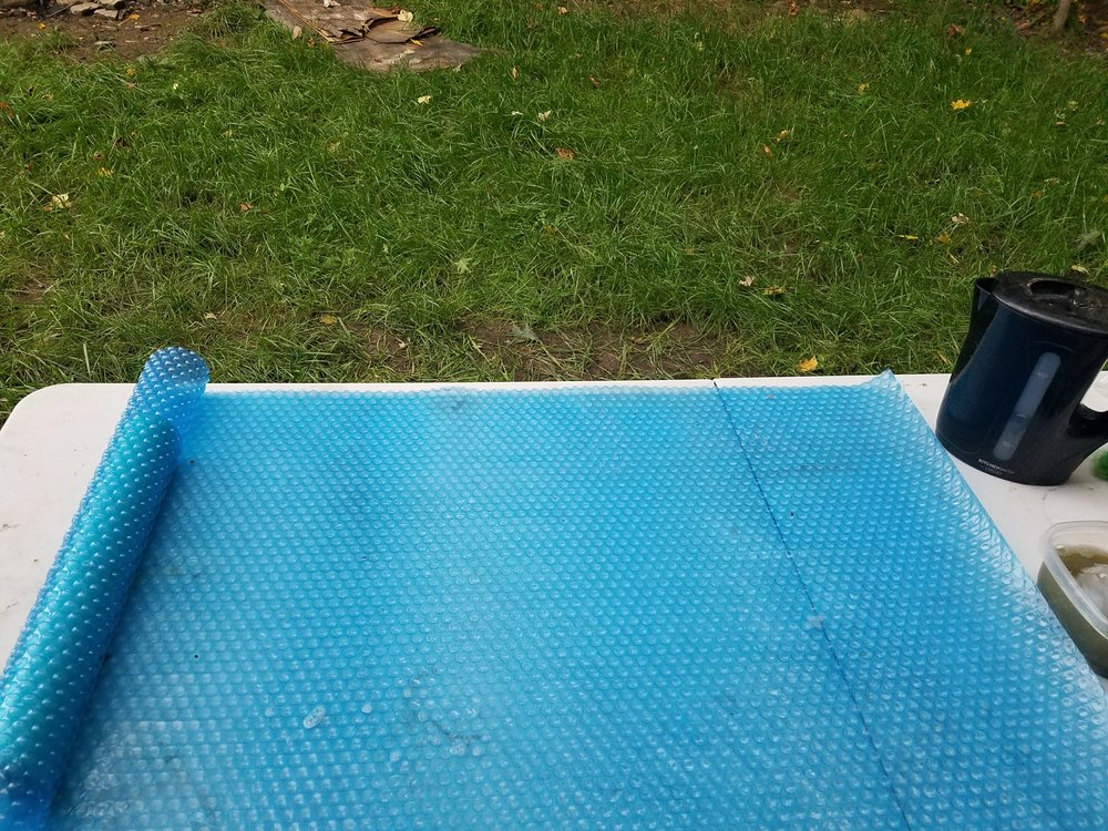Unroll your felting mat and remove the screen inside. Make sure you are working on the smooth side of your mat.