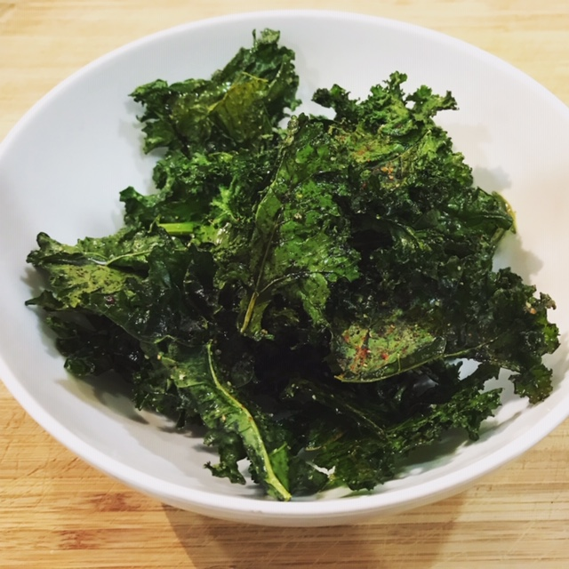 """KALE CHIPS - Ingredients1 bunch kale2 T. olive oilSalt and freshly ground black pepperDirectionsPreheat the oven to 275°F.Fill a large bowl with water and add kale. Swish around to remove any dirt; drain. Dry thoroughly using a clean kitchen towel or salad spinner.Tear the kale leaves into 1"""" – 2"""" pieces, discarding the ribs, and place in a bowl.Drizzle with olive oil and toss with your hands until evenly coated. Rub each leaf gently between your fingers as you work to ensure each is covered in oil.Arrange the leaves in a single layer (with NO overlap) on ungreased cookie sheet. Sprinkle with salt and pepper. Optional: Sprinkle a small amount of parmesan cheeseBake for 18 to 20 minutes or until leaves are crispy. Serve. Store in airtight container."""