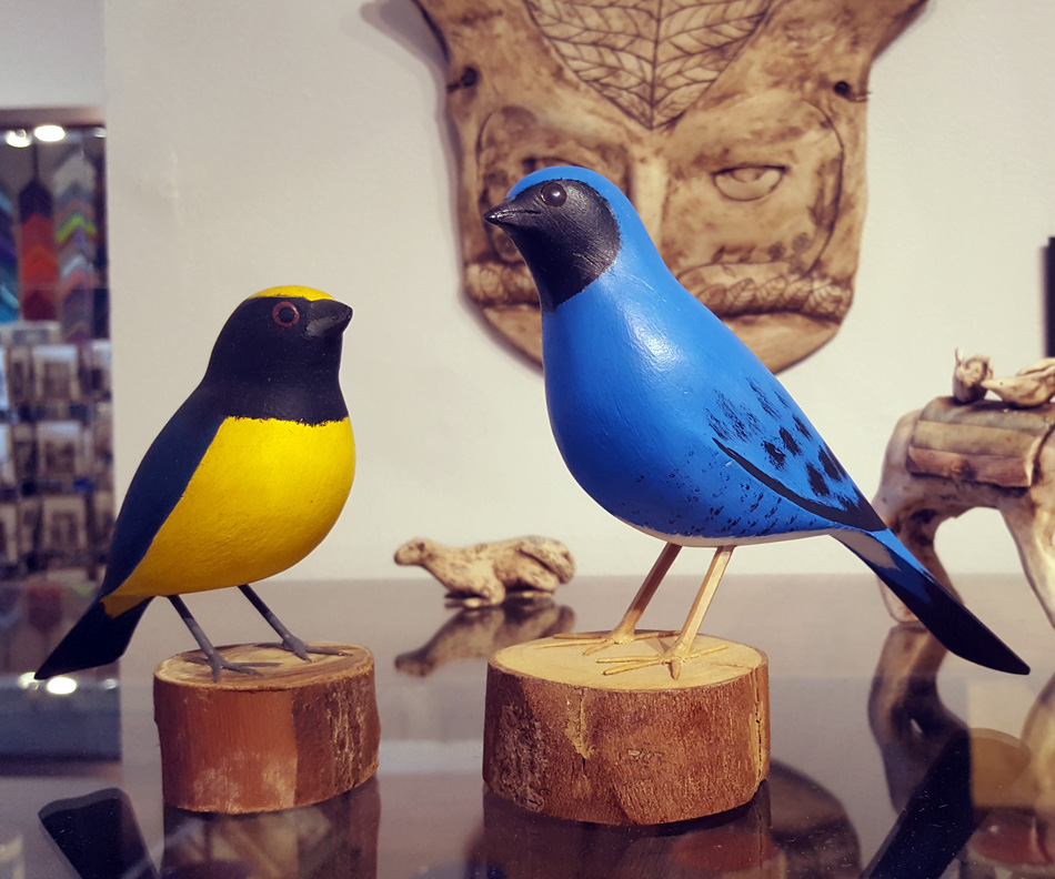 Hand-carved hardwood songbirds by Brazilian artisans.