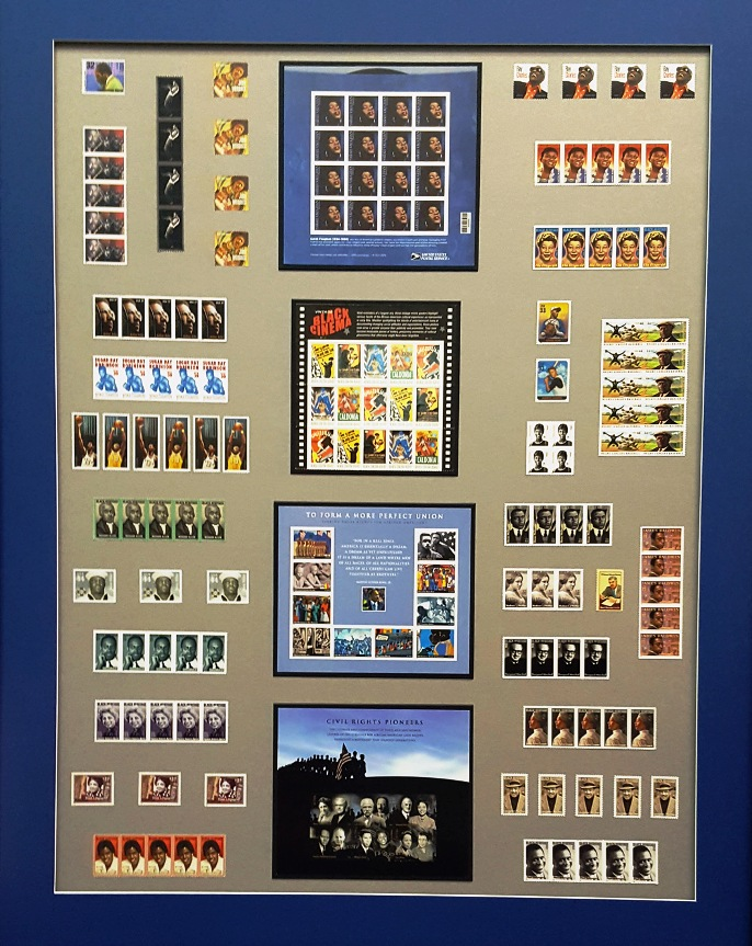 Stamp Collection With Archival Mats and Conservation Glass - A large collection of African-American commemorative stamps were organized into a balanced presentation on a taupe mat surrounded by a blue border. Our framers have the experience to help you create visual order from your collections.