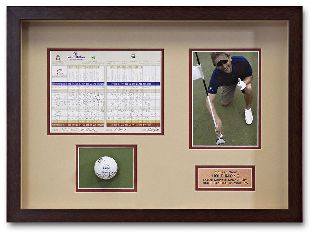 Remember the Time You Hit a Hole-In-One? Framing Tells A Story. - A shadowbox is a great way to tell a story. The score sheet, gold ball, and photo of this memorable event are cleanly organized inside a black frame. Double matting adds style and a touch of color.
