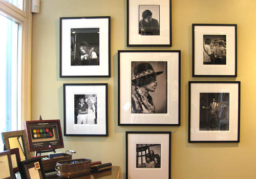Black & White Photography In Classic Gallery Framing - You can't go wrong with black frames and white conservation mats on original photographs. This collection was framed individually and hung as a collection. Repeating the same frame and mat proportions helps visually organize the concept. Ask about our installation services!