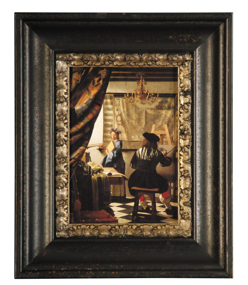 Make A Print Look Like The Real Deal With Custom Framing - So it's not a real Vermeer... who cares? With this frame, you could have fooled us. Wide dark framing is very Dutch and the silver gilded lip adds a luxe touch. The dark setting makes a dramatic window into the world of the artist and his model.