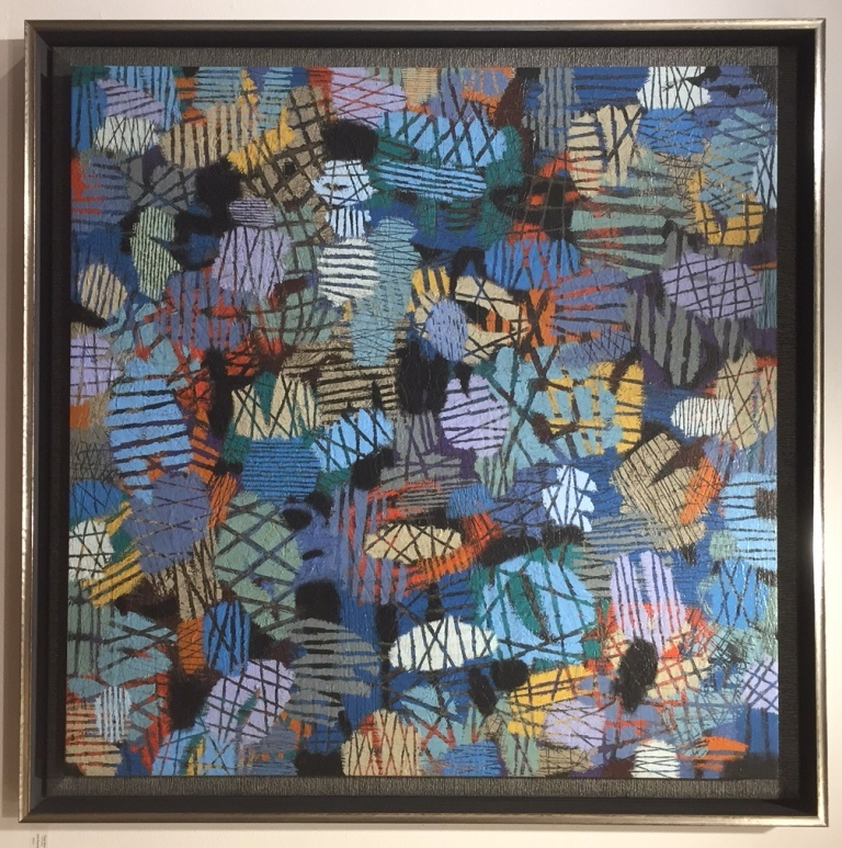 Contemporary abstract painting on canvas in a float frame for a modern look. We added a striped liner for additional visual interest and texture.