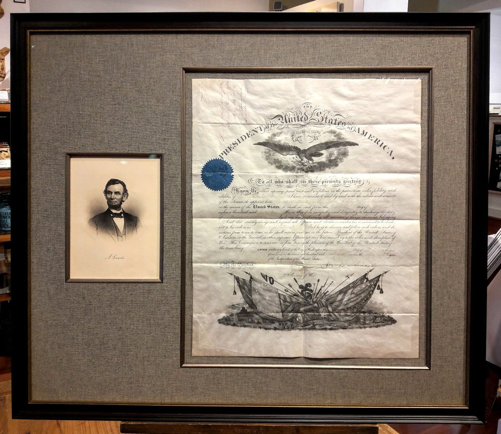 A photo of Abraham Lincoln is paired with a framed document signed by the President. We preserved this family heirloom with acid-free linen matting and Museum Glass. The dark inset frame and bronze filet were selected for dimension and elegance.