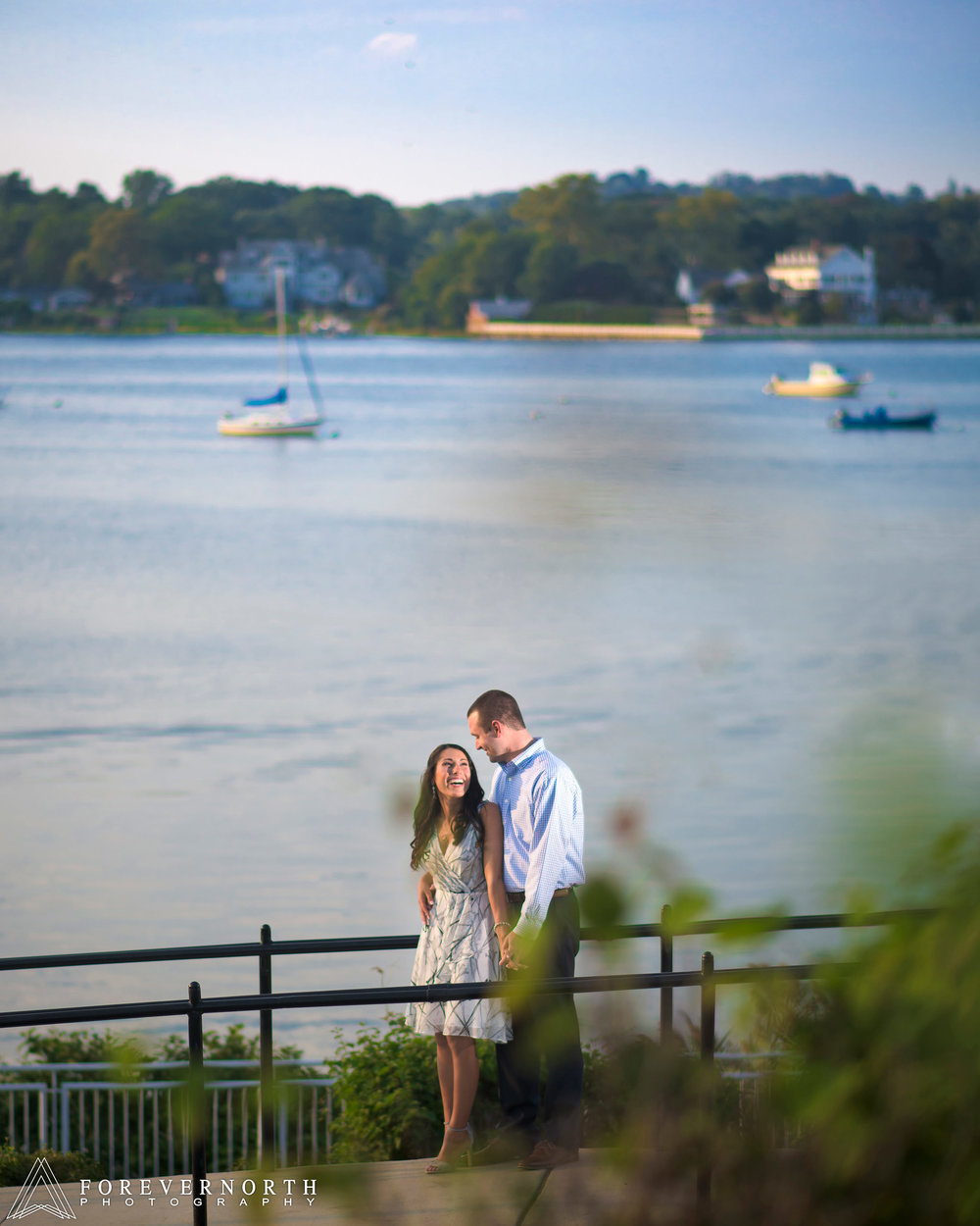 Through the bushes, the couple laugh with each other in red bank