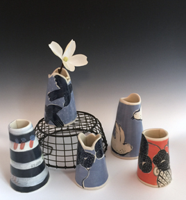 Pretty little  porcelain cone vases - available at Abrams Claghorn Gallery.