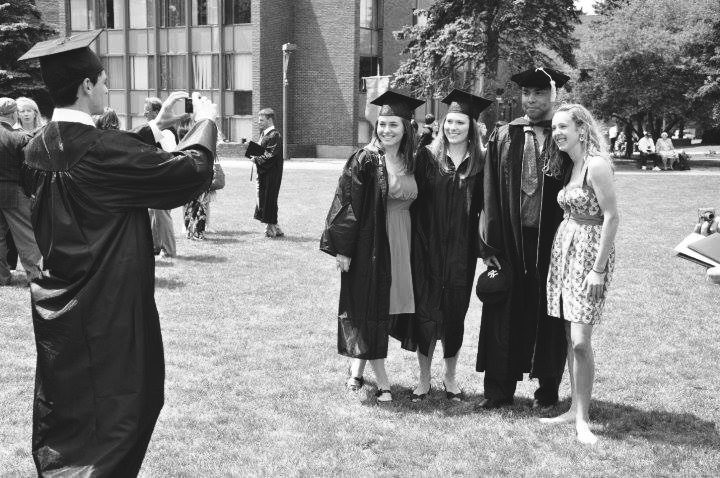 Dr. Holcomb with me (left, in the photo being taken), and a few friends from Gordon College on the day of our graduation.