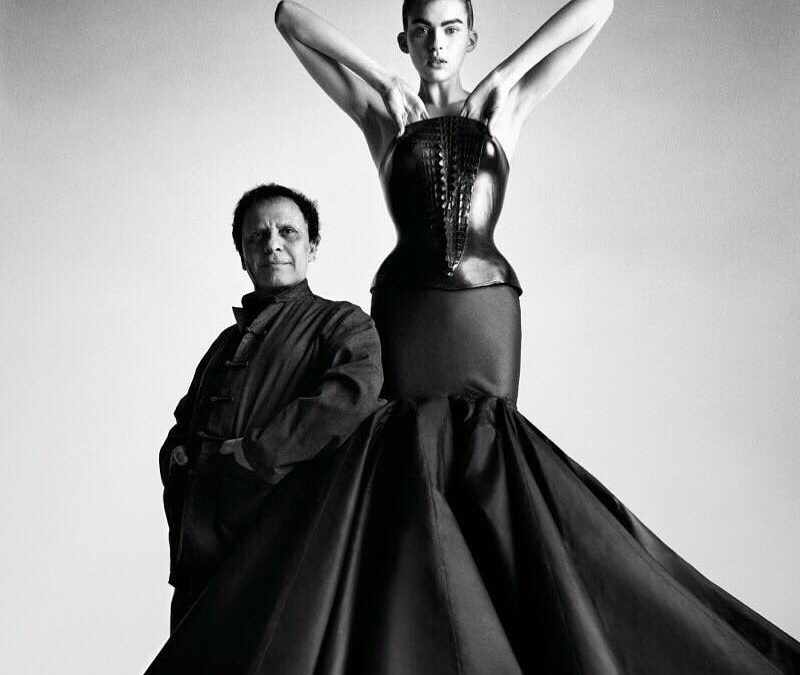 Azzedine Alaia and one of his designs.JPG
