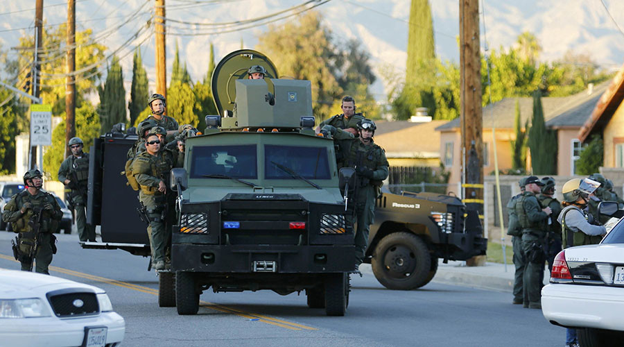 Police officers conduct a manhunt after a mass shooting in San Bernardino