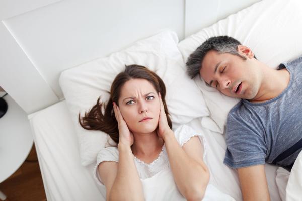 Husband snoring in wife's ear