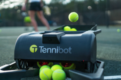 Tennibot picks up the balls for you.