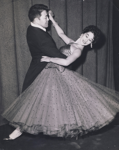 Ken Ota trained in ballroom dance with Sheila Webber-Sloan, a U.S. Dance Champion, winning awards and making television appearances.