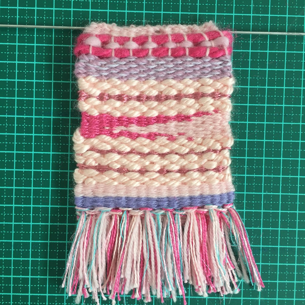 Unicorn inspired rya knot tassels.