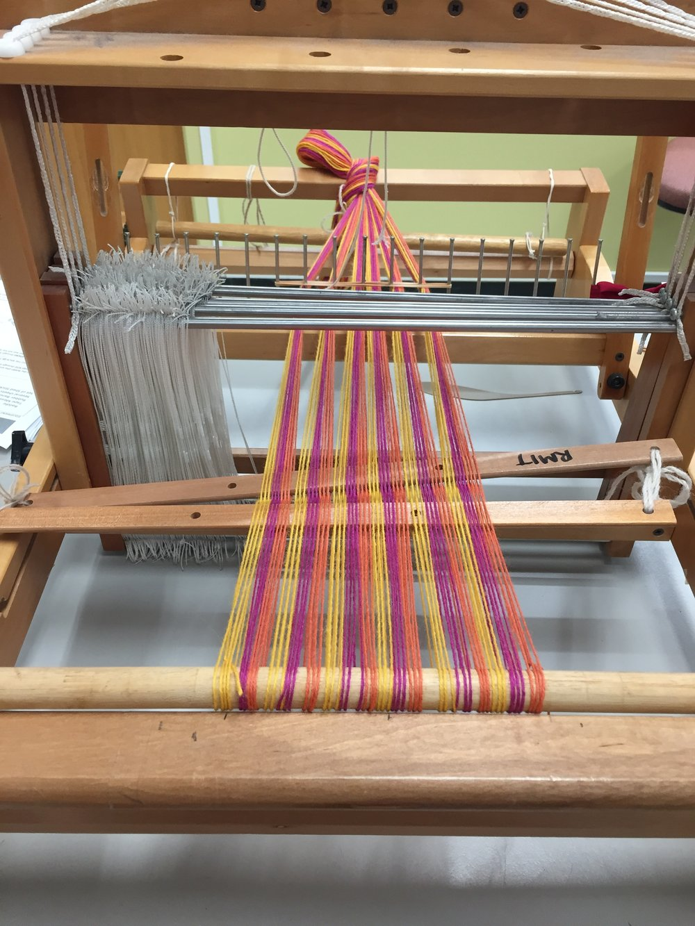 Preparing to thread the heddles.