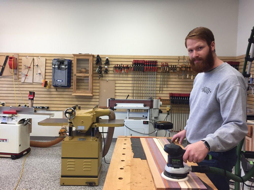 Josh learning to make a cutting board.
